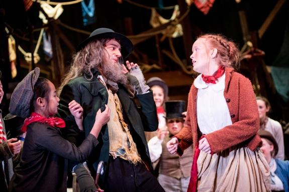 Luke Nunn as Fagin and company Photo credit: Graeme Braidwood